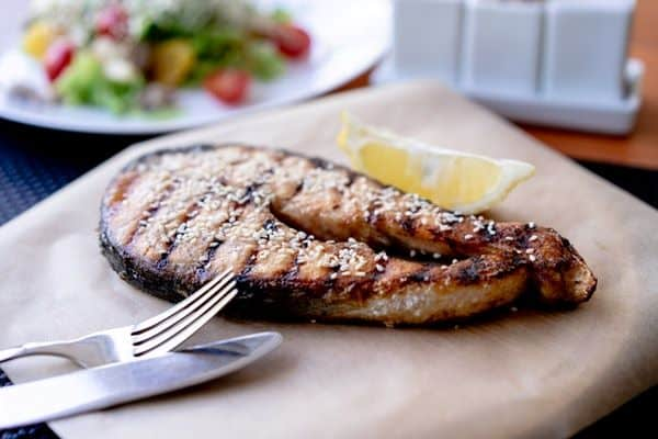 grilled fish with knife and fork in a platter