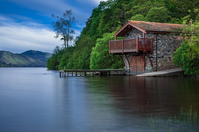 house at the side of the lake
