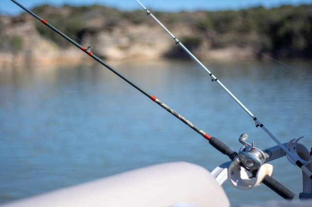 a fishing rod set up on a boat
