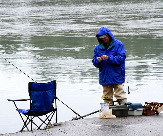 a man setting up his fishing gear
